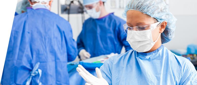 Surgical team wearing white surgical masks